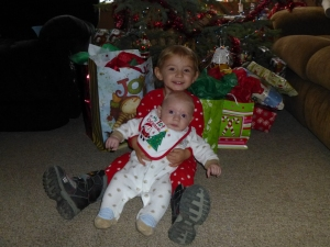 Our kids on Christmas morning. Yes, Elena is wearing snow boots. She normally refuses to take them off.