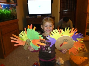 Elena with two of the turkeys we made together this week. The one on the right has listed some of the things she's thankful for this year: Joe-Joe, food, Mommy & Daddy, and snow (to name a few)