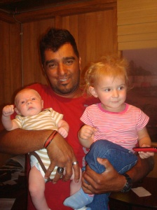 Tio Lucho with our kids, a month before we left Peru. Elena really did love her, I promise!