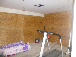 One half of the double garage will be a workout room for residents; the other half will be tool storage.