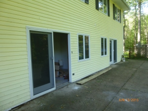 The entrances to the duplexes. The one that is complete is the sliding door closest.